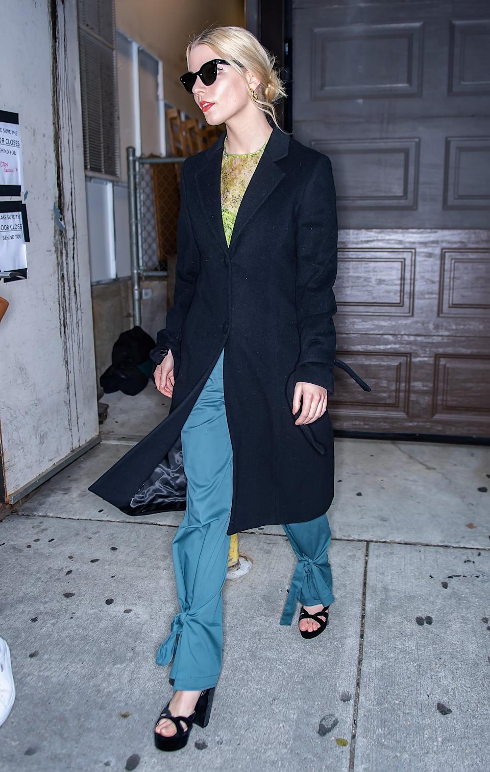 <p>Forever the trendsetter, Anya wore these teal tapered trousers with a green mesh print shirt and sky-high platforms in Philadelphia, PA.</p>
