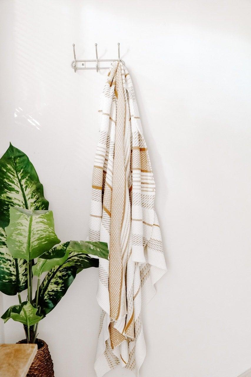 "<p>Hang this soft and cozy <a href=""https://www.popsugar.com/buy/Camel-Beige-Stripe-Throw-Blanket-582480?p_name=Camel%20and%20Beige%20Stripe%20Throw%20Blanket&retailer=effortlesscomposition.com&pid=582480&price=45&evar1=casa%3Aus&evar9=47553754&evar98=https%3A%2F%2Fwww.popsugar.com%2Fhome%2Fphoto-gallery%2F47553754%2Fimage%2F47553846%2FCamel-Beige-Stripe-Throw-Blanket&list1=shopping%2Chome%20decorating%2Chome%20shopping&prop13=api&pdata=1"" class=""link rapid-noclick-resp"" rel=""nofollow noopener"" target=""_blank"" data-ylk=""slk:Camel and Beige Stripe Throw Blanket"">Camel and Beige Stripe Throw Blanket</a> ($45) over your couch.</p>"