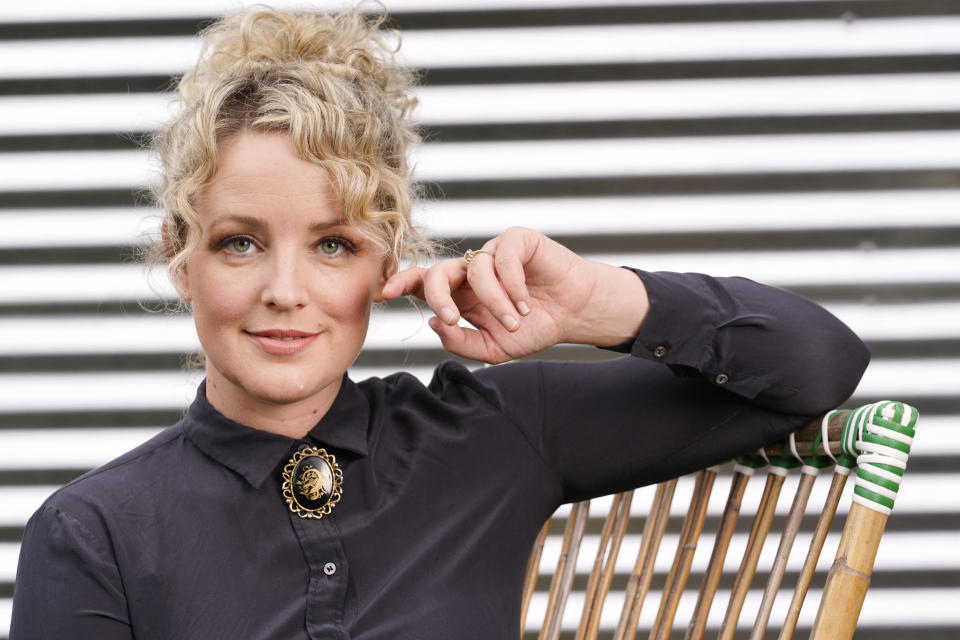 """Country singer Cam poses in Nashville, Tenn., on Wednesday, Sept. 23, 2020 to promote her second album """"The Otherside."""" (AP Photo/Mark Humphrey)"""