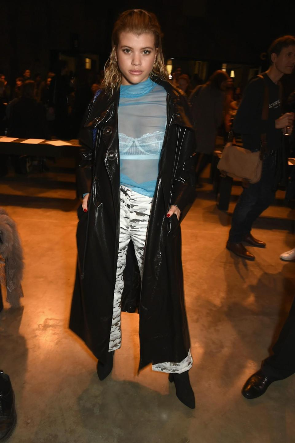 <p>Sofia Richie paired camo trousers with a sheer blue top. <i>[Photo: Getty]</i> </p>