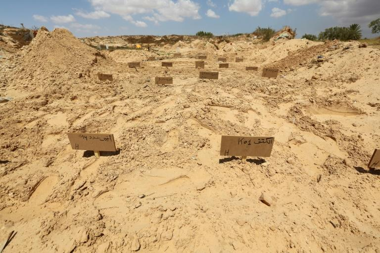 Wooden placards mark the makeshift tombs of African migrants whose bodies were recovered off Tunisia at a communal cemetery in El Ketif near the eastern coastal city of Zarzis (AFP Photo/FATHI NASRI)