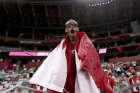 Gold medalist Mutaz Barshim of Qatar celebrates on the track after winning the final of the men's high jump at the 2020 Summer Olympics, Sunday, Aug. 1, 2021, in Tokyo, Japan. (Cameron Spencer/Pool Photo via AP)
