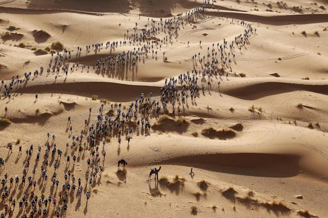 <p>Marathon des sables: Participants set off on a timed stage of the Marathon des Sables, in the Sahara Desert in southern Morocco.<br>The Marathon des Sables (Marathon of the Sands) is run over 250 kilometers in temperatures of up to 50℃. Participating runners and walkers must carry their own backpacks with food, sleeping gear, and other material. The marathon is conducted in six stages, over seven days, with one long stage of more than 80 kilometers. The first Marathon des Sables was held in 1986 with 186 competitors. The event now attracts more than 1,000 participants from around 50 countries. (Photo: Erik Sampers) </p>