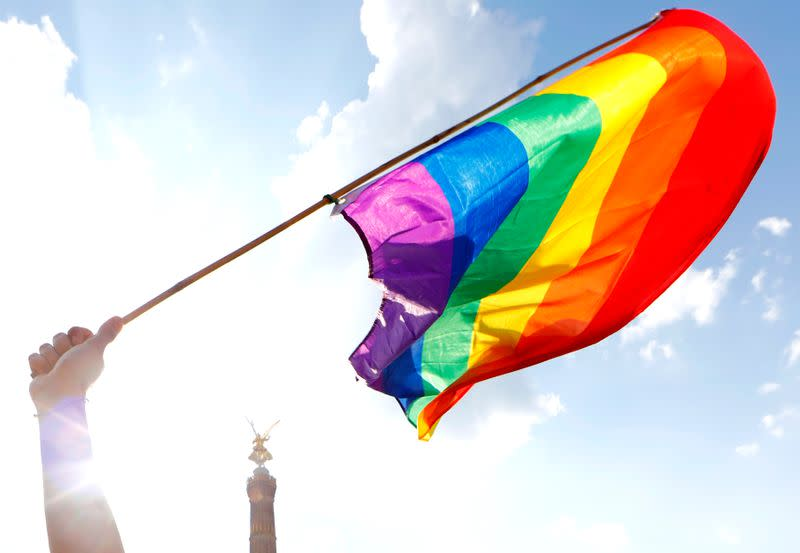 A rainbow flag is seen in front of the the Berlin Victory Column during the annual Gay Pride parade, also called Christopher Street Day parade (CSD), in Berlin,