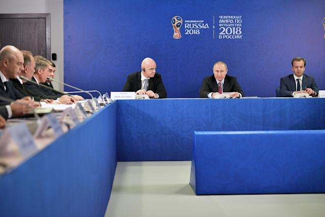 Russian President Vladimir Putin (2nd R), Deputy Prime Minister Arkady Dvorkovich (R) and FIFA President Gianni Infantino (3rd R) attend a meeting with members of the Supervisory Board of the 2018 FIFA World Cup Organising Committee in Sochi, Russia May 3, 2018. Sputnik/Aleksey Nikolskyi/Kremlin via REUTERS ATTENTION EDITORS - THIS IMAGE WAS PROVIDED BY A THIRD PARTY.