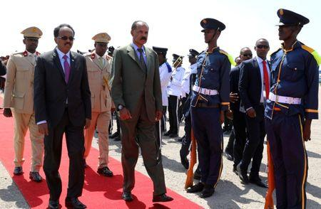 Eritrea's President Isaias Afwerki is welcomed by Somalia's President Mohamed Abdullahi Mohamed as he arrives at the Aden Abdulle International Airport in Mogadishu, Somalia December 13, 2018. REUTERS/Feisal Omar