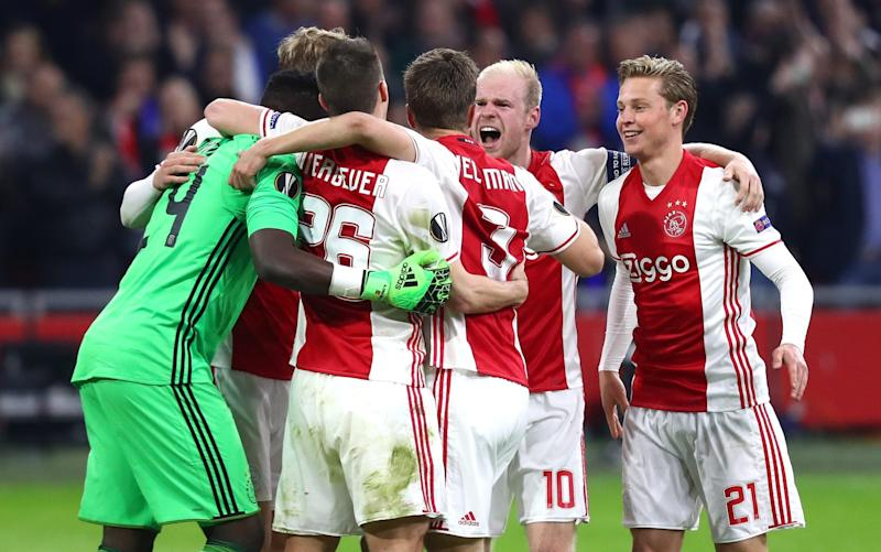 Ajax players, led by captain Davy Klaassen, celebrate their 2-0 win over Schalke on Thursday night - Bongarts