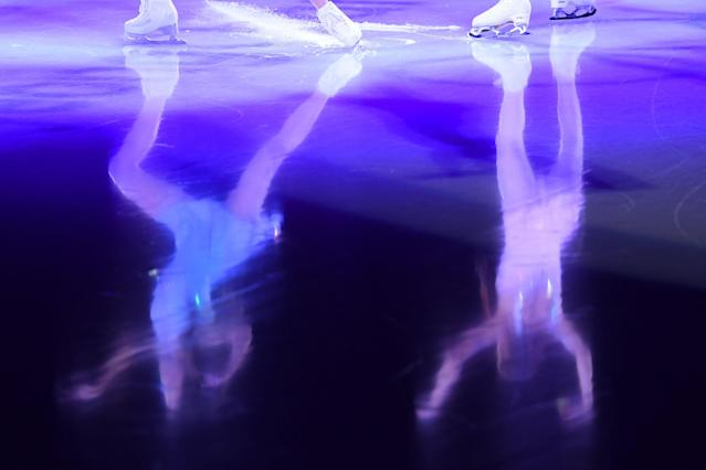 <p>Reflections of performers are seen on the ice during the figure skating gala event during the Pyeongchang 2018 Winter Olympic Games at the Gangneung Oval in Gangneung on February 25, 2018. / AFP PHOTO / Mladen ANTONOV (Photo credit should read MLADEN ANTONOV/AFP/Getty Images) </p>