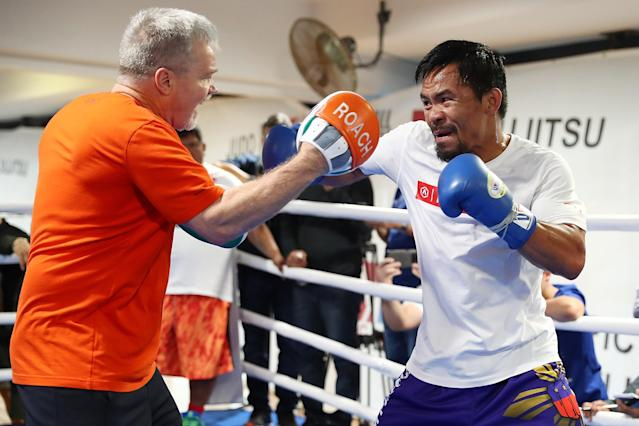 Freddie Roach (L) works with Manny Pacquiao during a training session at Lang Park PCYC on June 27, 2017 in Brisbane, Australia. (Getty Images)
