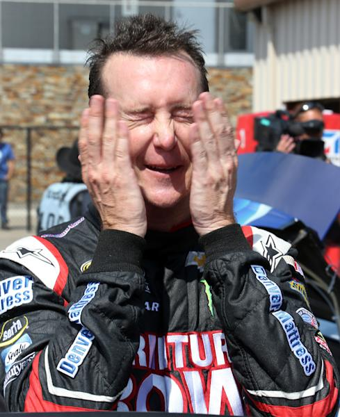 NASCAR Sprint Cup series driver Kurt Busch wipes his face after practice for the Pure Michigan 400 auto race at Michigan International Speedway in Brooklyn, Mich., Saturday, Aug. 17, 2013. (AP Photo/Bob Brodbeck)