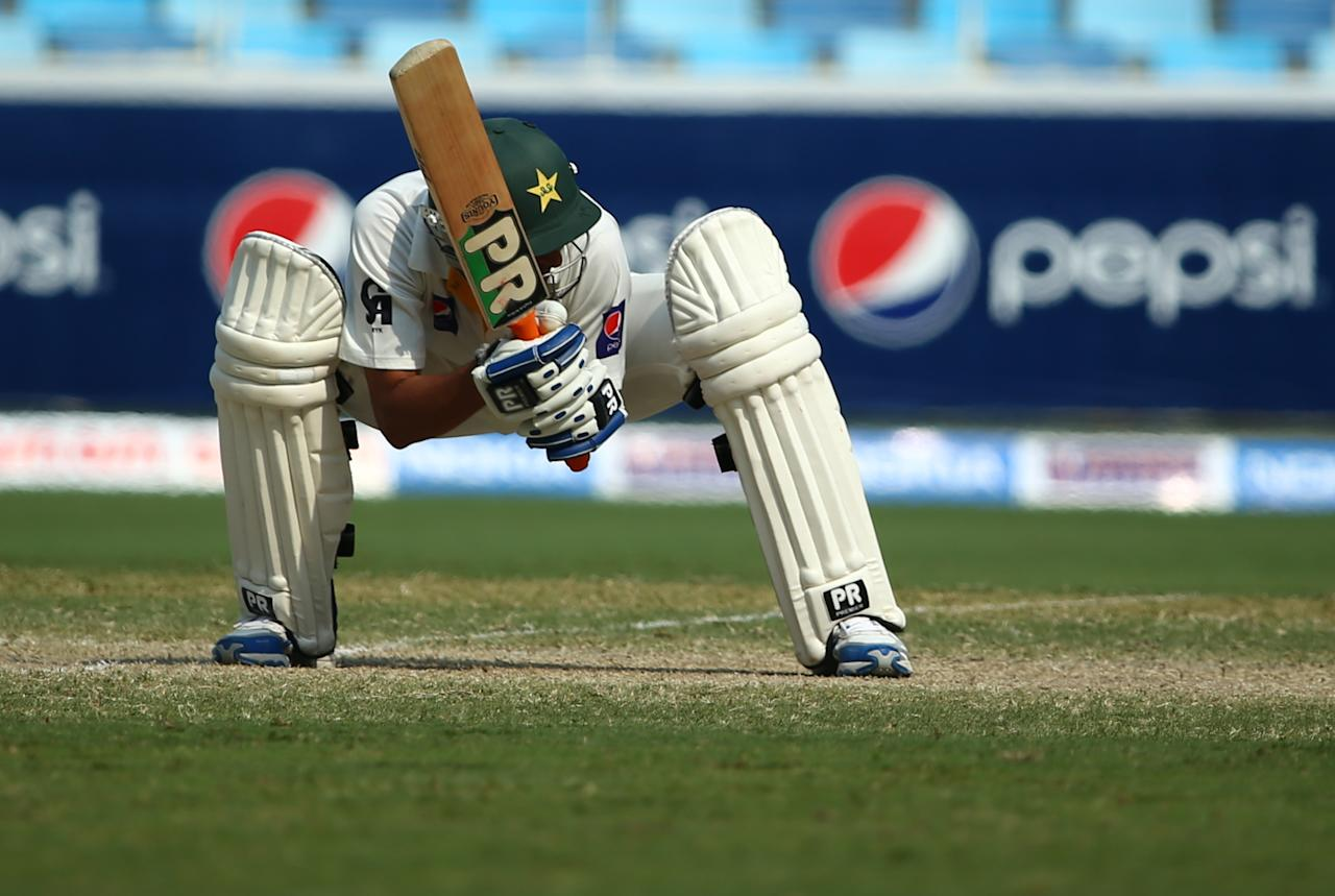 Pakistani, Younis Khan, avoids a bouncer during the third day of the second Test cricket match between Pakistan and South Africa in Dubai on October 25, 2013.      AFP PHOTO/ MARWAN NAAMANI        (Photo credit should read MARWAN NAAMANI/AFP/Getty Images)