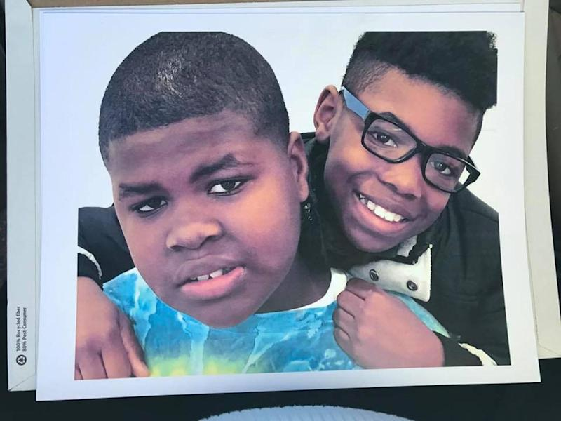 """My son (with glasses) and his twin brother. His brother has autism. They were raised apart but have recently been brought back together when we adopted our son. He sees his twin often now and cherishes their times. When his brother isn't understood by anyone else, my son can help others understand what his twin cannot express for himself. The face of autism in our house is the glow of brotherly love."""
