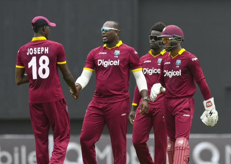 West Indies teammates celebrate the dismissal of Babar Azam of Pakistan caught by Alzarri Joseph (L) during the 1st ODI match between West Indies and Pakistan