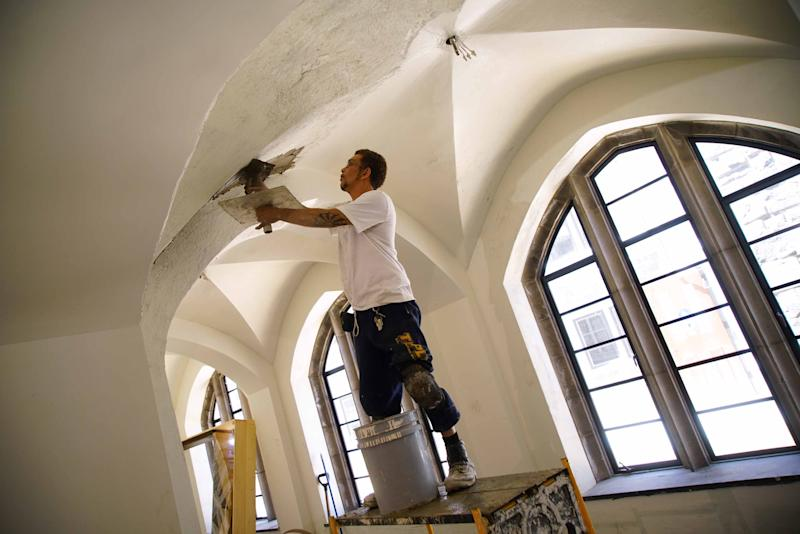 Workers continue the restoration and transformation of the former Cathedral Church of St. John on Concord Avenue that is being turned into Village of St. John, a 53 apartment living facility for seniors of low and moderate income.