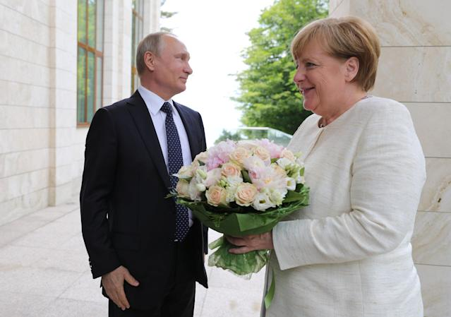 Russian President Vladimir Putin welcomes German Chancellor Angela Merkel during their meeting in the Black Sea resort of Sochi, Russia May 18, 2018. Sputnik/Mikhail Klimentyev/Kremlin via REUTERS ATTENTION EDITORS - THIS IMAGE WAS PROVIDED BY A THIRD PARTY.