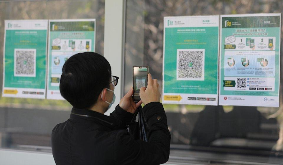App users will have to scan a QR code to record their visit to certain venues. Photo: Sam Tsang