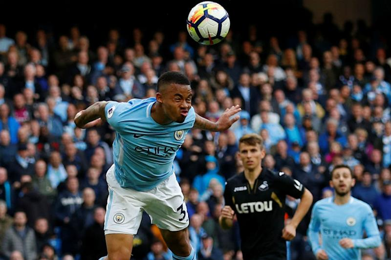 Man City Power Past Swansea in Search of Records