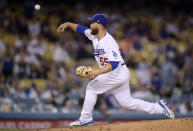 Los Angeles Dodgers' Russell Martin, whose normal position is catcher, pitches during the ninth inning of the team's baseball game against the Arizona Diamondbacks on Saturday, March 30, 2019, in Los Angeles. (AP Photo/Mark J. Terrill)