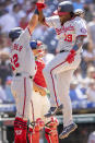 Washington Nationals' Josh Bell (19) celebrates with Kyle Schwarber (12) after hitting a grand slam home run during the sixth inning of a baseball game against the Philadelphia Phillies, Wednesday, June 23, 2021, in Philadelphia. (AP Photo/Laurence Kesterson)