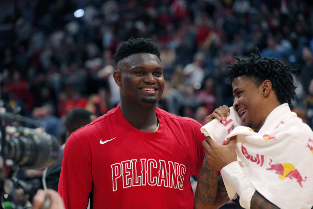 NBA Rookie of the Year candidates Zion Williamson, left, and Ja Morant greet each after a game in January. (AP Photo/Gerald Herbert)