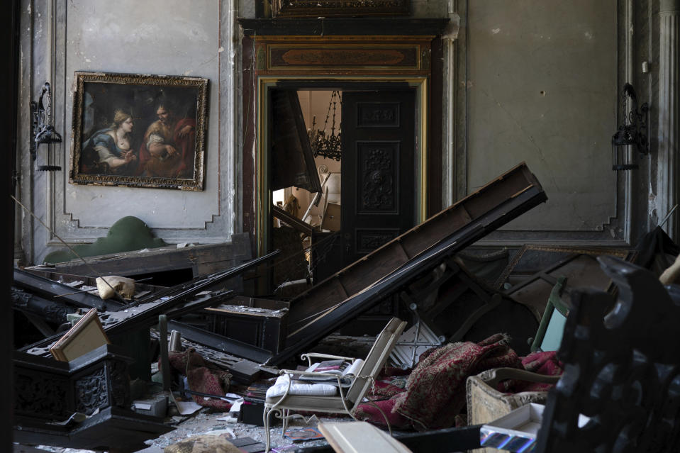 A painting hangs on the wall of a heavily damaged room in the Sursock Palace after the explosion in the seaport of Beirut, Lebanon, Saturday, Aug. 8, 2020. The level of destruction from the massive explosion at Beirut's port last week is ten times worse than what 15 years of civil war did. (AP Photo/Felipe Dana)