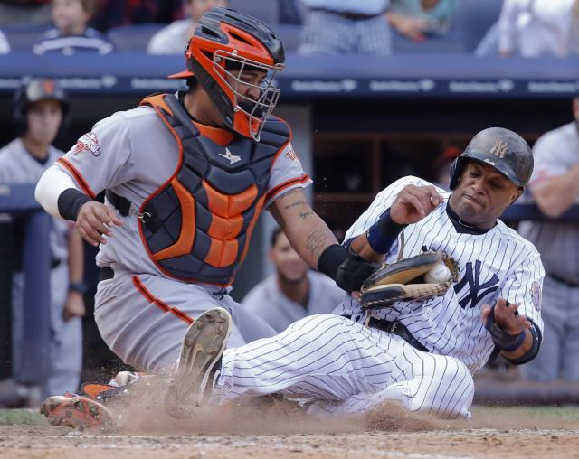 San Francisco Giants catcher Hector Sanchez tags out New York Yankees runner Robinson Cano (R) at home plate in the eighth inning of their MLB Interleague game at Yankee Stadium in New York, September 22, 2013. REUTERS/POOL/Elsa (UNITED STATES - Tags: SPORT BASEBALL)