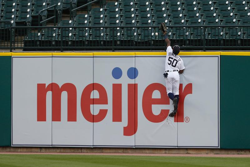 Detroit Tigers right fielder Travis Demeritte is unable to make a leaping catch at the wall on a home run by Chicago White Sox left fielder Eloy Jimenez during the first inning at Comerica Park, Aug. 11, 2020.