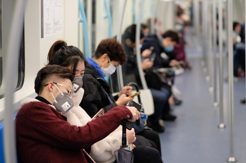 Shanghai/China-Jan.2020: New type coronavirus pneumonia in Wuhan has been spreading many cities in China. People wearing surgical mask sitting in subway in Shanghai