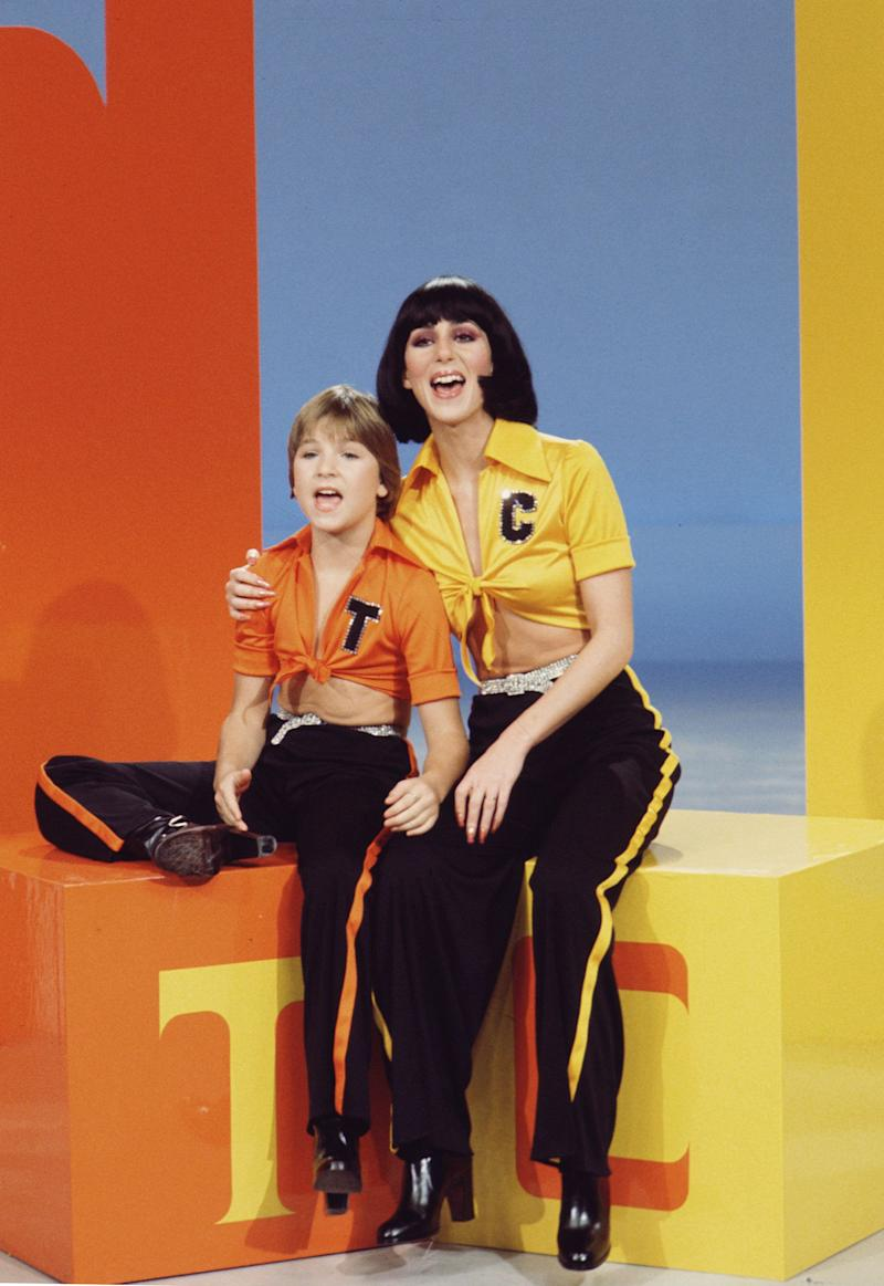 American child actrss Tatum O'Neal and singer/actress Cher (born Cherilyn Sarkisian LaPiere) appear together in coordinated outfits on the television variety show 'The Sonny & Cher Comedy Hour,' 1972. (Photo by CBS Photo Archive/Getty Images)