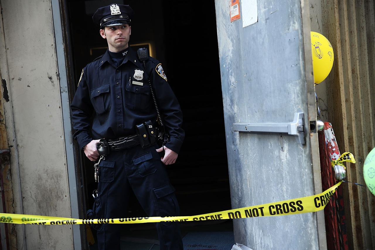 NEW YORK, NY - APRIL 26:  A police officer stands in front of the building on Park Place in lower Manhattan where a piece of landing gear believed to be from one of the planes destroyed in the September 11 attacks has been discovered on April 26, 2013 in New York City. The landing gear was discovered wedged between a mosque site and luxury high-rise apartment building, about three blocks north from the World Trade Center site.  (Photo by Spencer Platt/Getty Images)