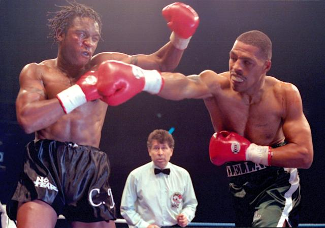LONDON - FEBRUARY 25,1995: Nigel Benn (L) throws a left hook against Gerald McClellan during the fight at New London Arena on February 25, 1995 in Millwall, London, United Kingdom. Nigel Benn won the WBC super middleweight title.(Photo by: The Ring Magazine/Getty Images)