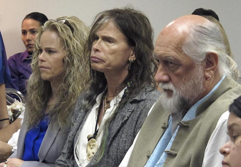 FILE This Friday Feb. 8,2013 file photo shows Aerosmith lead singer Steven Tyler, center, with his attorney Dina LaPolt, left, and Fleetwood Mac drummer Mick Fleetwood as they listen to testimony on a celebrity privacy bill during a hearing at the Hawaii Capitol in Honolulu. The future is looking bleak for the Hawaii celebrity privacy bill known as the Steven Tyler Act. The proposal pushed by the Aerosmith lead singer is missing deadlines in the state House and key lawmakers say they won't push it through. (AP Photo/Oskar Garcia,File)
