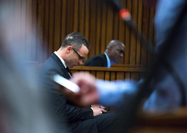 Oscar Pistorius, on his arrival in court for his ongoing murder trial in Pretoria, South Africa, Tuesday, May 13, 2014. Pistorius is charged with the shooting death of his girlfriend Reeva Steenkamp on Valentine's Day in 2013. (AP Photo/Daniel Born, Pool)
