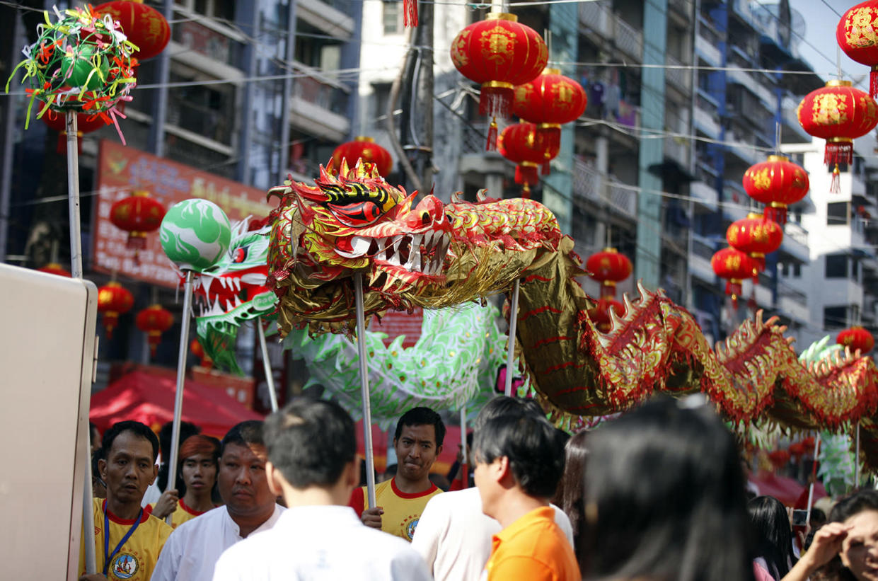 Local Chinese artists perform a dragon dance during celebrations to mark Lunar New Year at Chinatown Saturday, Jan.28, 2017, in Yangon, Myanmar. Saturday marks the Year of the Rooster in the Chinese calendar. (AP Photo/Thein Zaw)