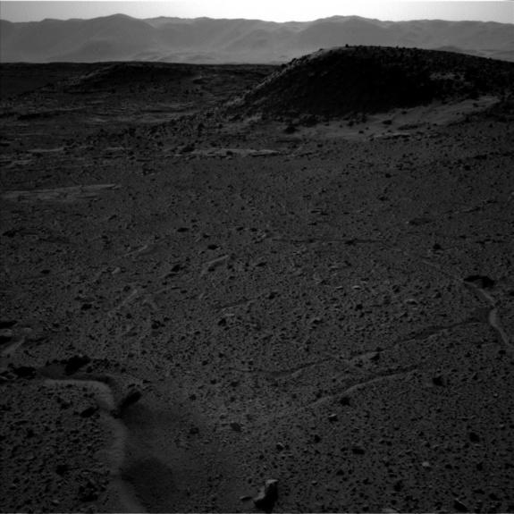 This image — captured by the left-side navigation camera on NASA's Mars Curiosity rover on April 3, 2014 — shows the same Martian locale where a bright flash seemed to appear that day in an image taken by the righthand navcam. Though the two na
