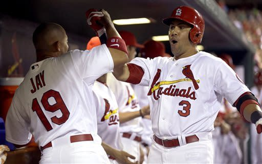 St. Louis Cardinals' Carlos Beltran, right, is congratulated by Jon Jay after hitting a three-run home run during the fifth inning of a baseball game against the New York Mets on Tuesday, May 14, 2013, in St. Louis. (AP Photo/Jeff Roberson)