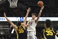 Northwestern forward Pete Nance (22) shoots over Iowa center Luka Garza (55) during the second half of an NCAA college basketball game Tuesday, Jan. 14, 2020, in Evanston, Ill. (AP Photo/David Banks)