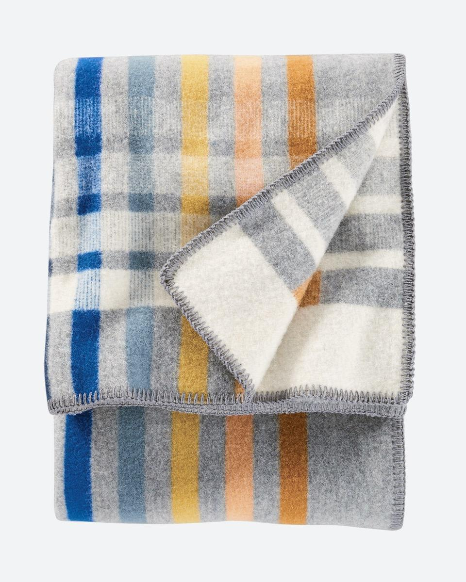 gray, blue, orange, and yellow pendleton blanket