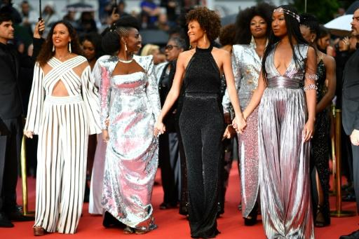 Hand in hand in protest: from lrft) French actress and producer France Zobda, French actress Aissa Maiga, French writer Rachel Khan and French actress Nadege Beausson-Diagne