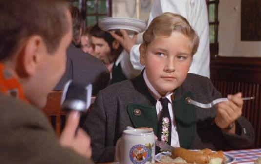 "<p>The part of Augustus Gloop in <em><a href=""https://www.goodhousekeeping.com/life/entertainment/g2778/willy-wonka-actors-look-like-now/"" rel=""nofollow noopener"" target=""_blank"" data-ylk=""slk:Willy Wonka & the Chocolate Factory"" class=""link rapid-noclick-resp"">Willy Wonka & the Chocolate Factory</a></em> was Bollner's acting debut, despite the fact that he only spoke German and had to be coached through his lines during shooting. Augustus is a greedy, gluttonous boy who is the first child to find a Golden Ticket — and the first child to be kicked off the tour of the factory.</p>"