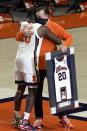 Illinois guard Da'Monte Williams (20) gets a hug from coach Brad Underwood as he receives his jersey during senior night, at the team's NCAA college basketball game against Nebraska on Thursday, Feb. 25, 2021, in Champaign, Ill. (AP Photo/Holly Hart)