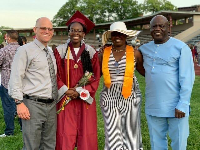 Verda Tetteh with her family and Principal Jeremy Roche.