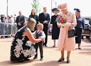 """<p>""""In this book, I endeavor to illustrate some of the Queen's personality — not only her famous resilience and dedication to duty, but also the warmth and humility behind the famously professional demeanor,"""" writes Getty photographer Chris Jackson in <em>Elizabeth II: A Queen for Our Time</em>.</p> <p>That warmth was on display in June 2010 when 2-year-old Lewis Connet was clearly overcome by the chance to give flowers to the monarch when she and Prince Philip opened the Alder Hey Children's Hospital in Liverpool.</p>"""