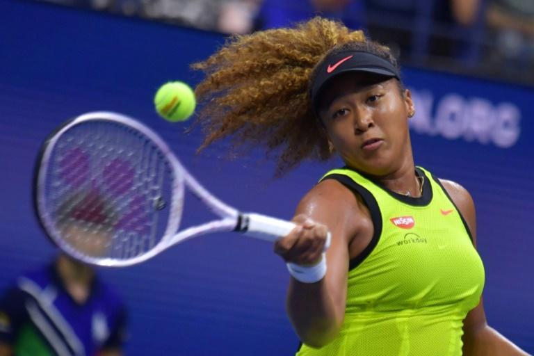 Japan's Naomi Osaka defeated Czech Marie Bouzkova in a first-round match on Monday at the US Open (AFP/Ed JONES)