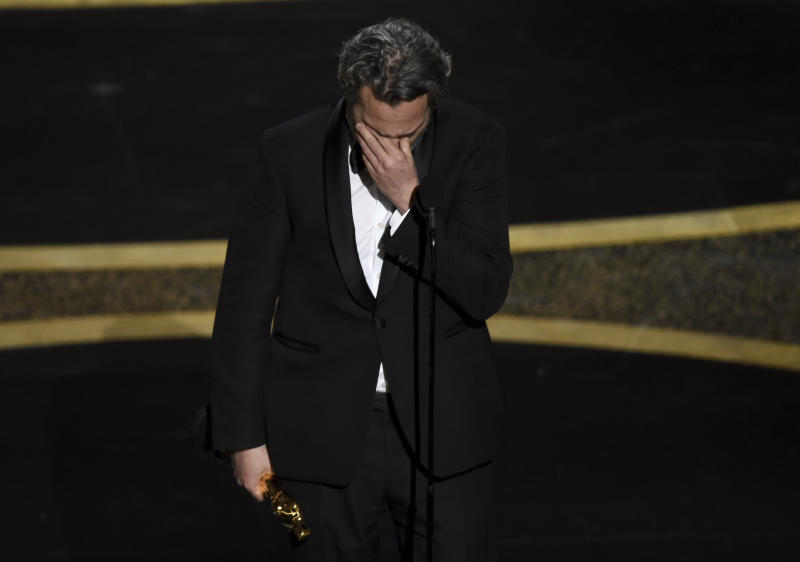 "Joaquin Phoenix reacts as he accepts the award for best performance by an actor in a leading role for ""Joker"" at the Oscars on Sunday, Feb. 9, 2020, at the Dolby Theatre in Los Angeles. (AP Photo/Chris Pizzello)"