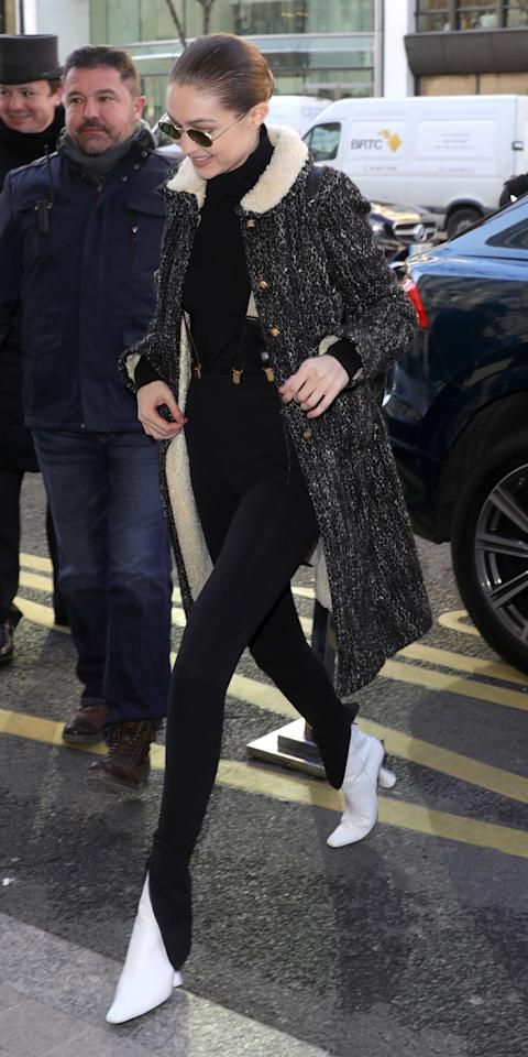 <p>Our eyes were first drawn to the model's black pants and white boots combination (classic!), but we quickly spotted the best part of her look: suspenders! The standout accessory was nearly hidden under her comfy winter coat.</p>