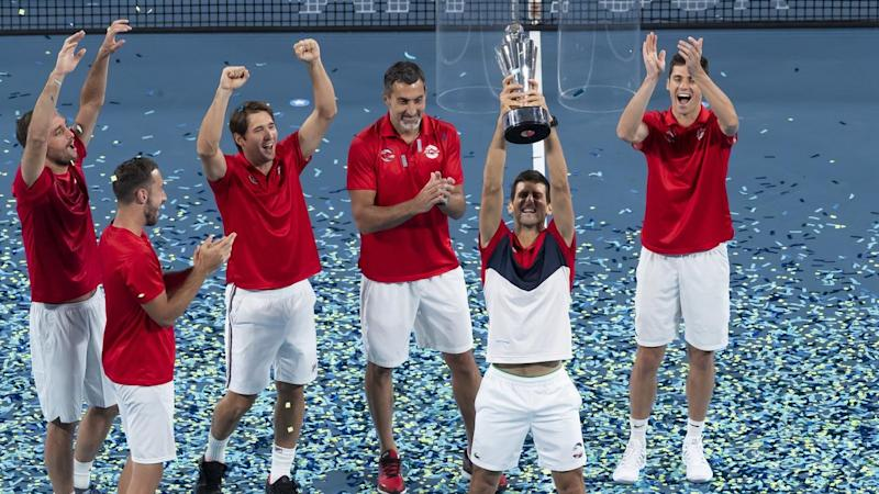 Novak Djokovic (2-R) has led Serbia to victory at the innaugural ATP Cup in Sydney