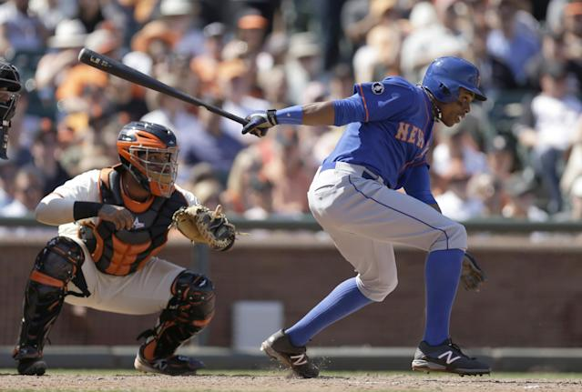 New York Mets' Curtis Granderson hits a double off San Francisco Giants' Jeremy Affeldt in the eighth inning of a baseball game Sunday, June 8, 2014, in San Francisco. (AP Photo/Ben Margot)