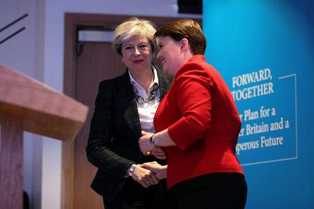 Scottish Conservative leader Ruth Davidson speaks to Britain's Prime Minister Theresa May as they launch the Scottish manifesto in Edinburgh