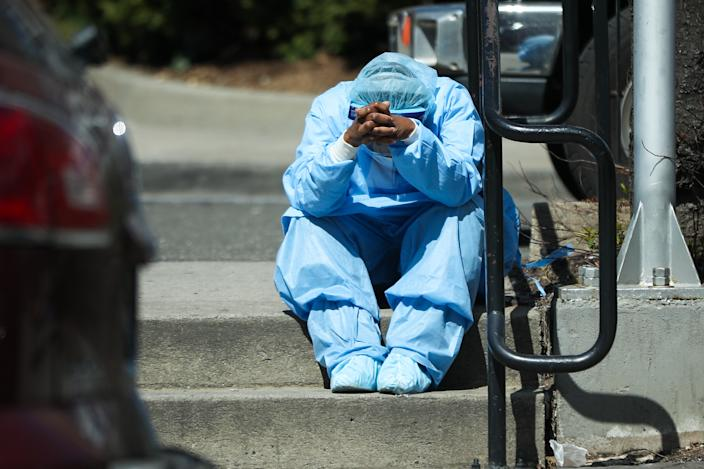 A sad and tired healthcare worker is seen by the Brooklyn Hospital Center in New York, United States on April 1, 2020. New York is the U.S. state worst-hit by the pandemic. (Tayfun Coskun/Anadolu Agency via Getty Images)